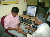 Physiotherapist entering data in HMS